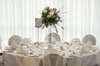 tall floral centrepiece with green and white flowers