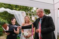 Guest doing a funny reading during an intimate elopement ceremony