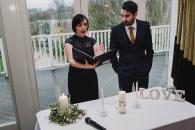 Wedding celebrant discusses ceremony with groom