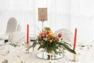 red and coral floral centrepiece