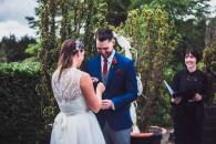 Couple exchanging rings at Cloghan Castle
