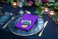 table setting in purple and gold