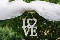 Ceremony backdrop with tulle and love sign