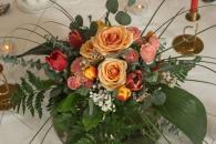 low wedding centrepiece with coral and pink flowers