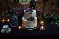 wedding cake with purple cake flowers