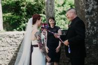 Couple tying the knot in a hand fasting ceremony